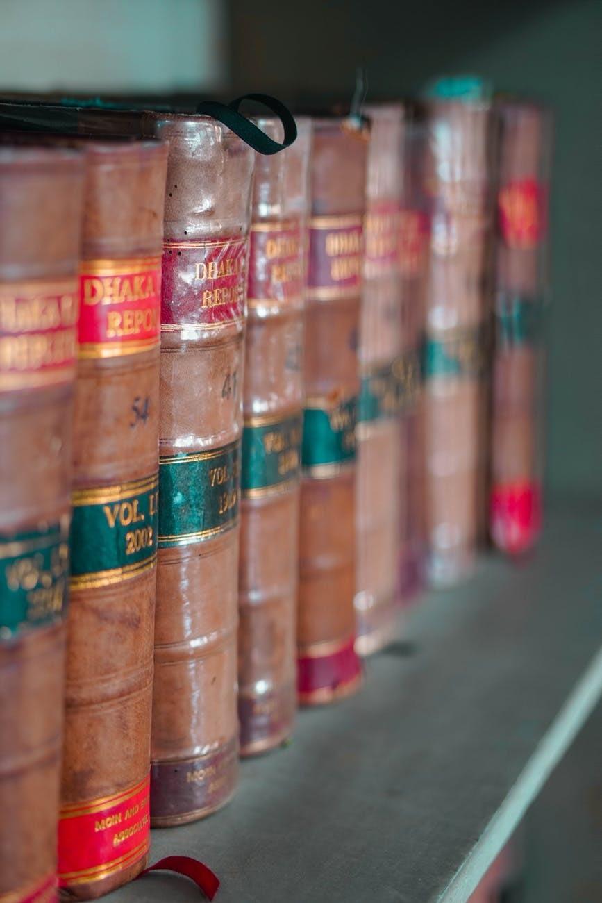 piled books on a shelf